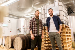 Men at craft brewery or beer plant. Manufacture, business and people concept - men at craft brewery or beer plant stock image