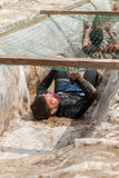 Men creep on an entrenchment with sand and water Stock Photos