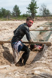 Men creep on an entrenchment with sand and water Stock Photo