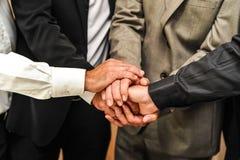 Men cross hands Stock Photography