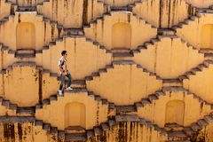 Men crossing the stepwells of Chand Baori in Jaipur India.
