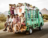 Men crowd into the back of a truck to be transported to work in. Kochi, India, Mar 4, 2018, Men ride in truck - Men crowd into the back of a truck to be Royalty Free Stock Image