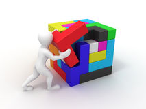 Men with a cube built from blocks. Puzzle Royalty Free Stock Photos