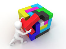 Men with a cube built from blocks. Puzzle Stock Photos
