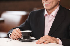 Men with cup of coffee. Cropped image of businessman drinking co Royalty Free Stock Photos