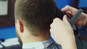 Men cut their hair shaver. Barbershop stock video