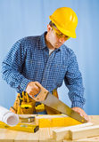 Men cutting plank Royalty Free Stock Images