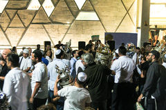 Men dance with Bible scrolls during the ceremony of Simhath Torah. Tel Aviv. Israel Royalty Free Stock Photos