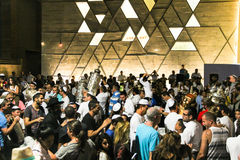 Men dance with Bible scrolls during the ceremony of Simhath Torah. Tel Aviv. Israel Stock Image