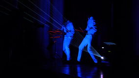 2 men dance and play electronic drums during the laser show. HD stock footage
