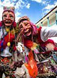 Men dancing and wearing typical masks at Paucartambo's religious festival of Virgen del Carmen. royalty free stock images