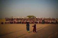 Men dancing Yaake dance and sing at Guerewol festival in InGall village, Agadez, Niger. Men dancing Yaake dance and sing at Guerewol festival - 23 september 2017 Stock Image