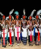 Men dancing Yaake dance and sing at Guerewol festival in InGall village, Agadez, Niger. Men dancing Yaake dance and sing at Guerewol festival - 23 september 2017 Stock Images