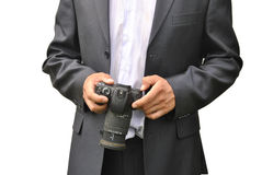 Men in dark suit. With photo camera Royalty Free Stock Images