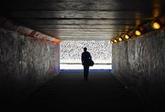 Men in the dark tunnel. One men in the dark tunnel stock photo