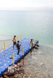 Men on  the Dead Sea Royalty Free Stock Photos