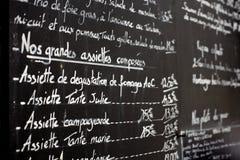 Menú del restaurante en París Imágenes de archivo libres de regalías