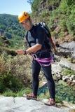 Men descending waterfall Stock Photography