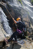 Men descending waterfall Stock Photography