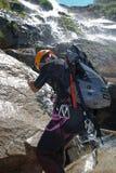 Men descending waterfall Stock Images