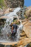 Men descending waterfall Royalty Free Stock Image