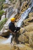 Men descending waterfall. Men descending in rappeling a waterfall Stock Photos