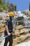 Men descending waterfall. Men descending in rappeling a waterfall Royalty Free Stock Photos