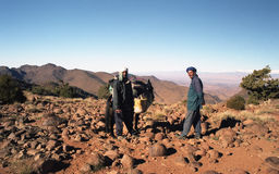 Men of desert. If you do some trek in desert, all you need is a good guide and a good cook.Here, in Djebel Sahro before Sahara desert stock images