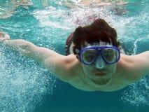 Men dive with bubbles stock image