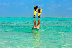 Men dive snorkeling in clear water with yellow flippers Stock Photos
