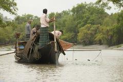 Men do fishing with otters, Mongla, Bangladesh. stock photo