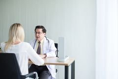 Man doctor examining to woman patient,Infertility counseling and suggestion at hospital. Men doctor examining to women patient,Infertility counseling and stock images