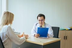 Man doctor examining to female patient,Infertility counseling and suggestion using new technology. Men doctor examining to women patient,Infertility counseling stock photo