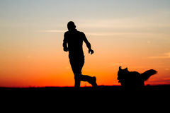 Men &Dog Silhouette. Beautiful Men & Dog Silhouette / Sunrise Landscape Royalty Free Stock Photo