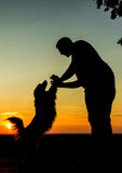 Men & Dog Silhouette. Beautiful Men & Dog Silhouette / Sunset Landscape Royalty Free Stock Images