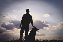 Men & Dog Silhouette. Beautiful Men & Dog Silhouette / Sunset Landscape Stock Photography