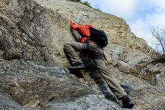 Men doing a climbing line in Canillo, Andorra. Young man doing a climbing line in Canillo, Andorra royalty free stock image
