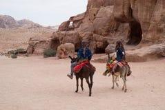 Men on donkeys Petra Jordanl, Petra, Jordan, Middle East Stock Image