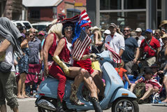 Men in drag on motor scooter celebrate July 4, Independence Day Parade, Telluride, Colorado, USA Stock Photos