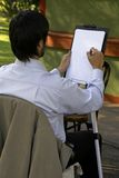 Men Drawing. A Men Drawing Caricature of a Kid Royalty Free Stock Photography