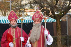Men dressed as St. Nicholas pose for photo Stock Photos