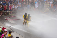 Men dressed in yellow firemen slickers Royalty Free Stock Photos