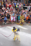 Men dressed in yellow firemen slickers Royalty Free Stock Image