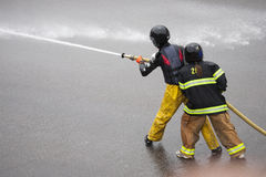 Men dressed in yellow firemen slickers Royalty Free Stock Photography