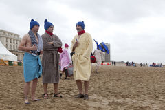 Men in dressing gowns on the beach Stock Photos