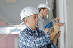 Men drilling wall with drill perforator Royalty Free Stock Images