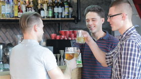 Men drink beverages at the bar counter stock footage