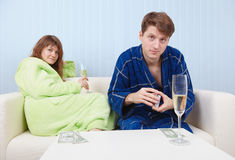 Men drink sparkling wine and play on money Stock Photography
