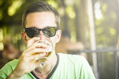Men drinking beer. Portrait of handsome young man drinking beer and looking at lens royalty free stock image