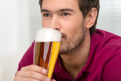 Men drinking beer. Portrait of handsome young men drinking beer Royalty Free Stock Photography